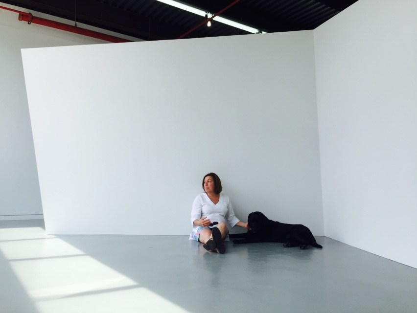 Gallerist Ellen Hackl Fagan and her dog in front of a sculpture by Thomas Lendvai