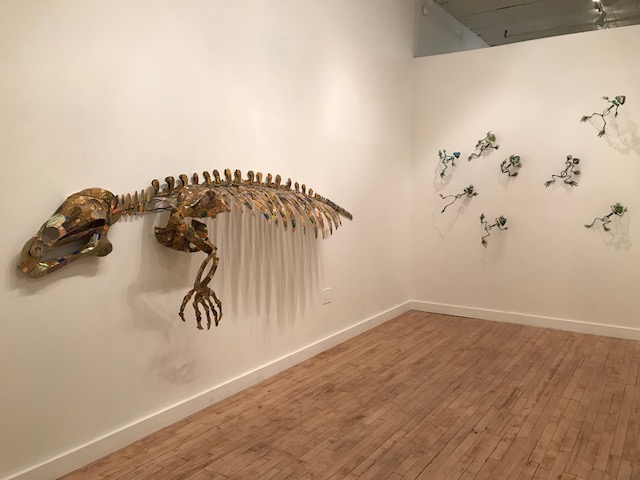 Christy Rupp, room intallation: (left) Manatee Skeleton, 2015, welded steel credit solicitations, mixed media, 43x122x17in, (back) Swiped, 2015, welded steel and green credit cards, 8x9x5in